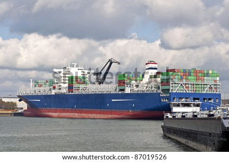 container ship and oil tanker in the harbor of Rotterdam - stock photo