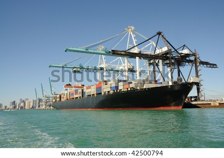 Container ship at industrial port - stock photo