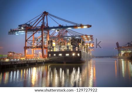 Container ship at night. Hamburg, Germany. - stock photo