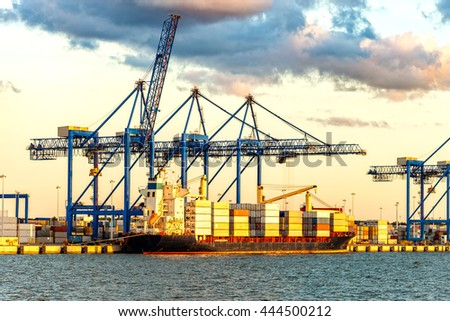 Container ship at sunset in Port of Gdansk, Poland - stock photo