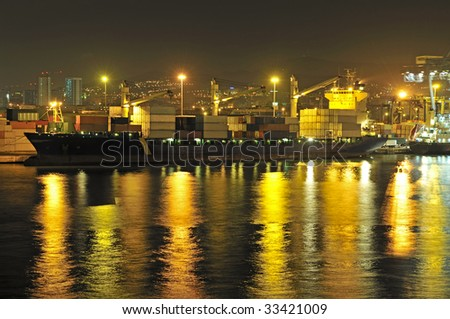 Container ship during load operations - stock photo