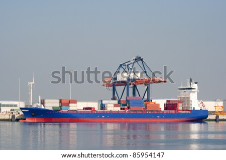 Container ship in a harbor - stock photo