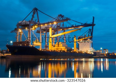 Container ship in asia port while load the job. - stock photo