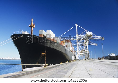 Container ship in docks - stock photo