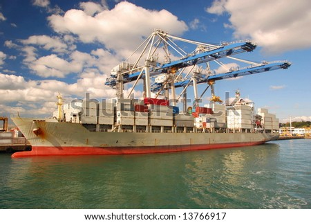 Container ship in Port of Auckland, New Zealand - stock photo