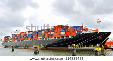container ship in terminal - stock photo