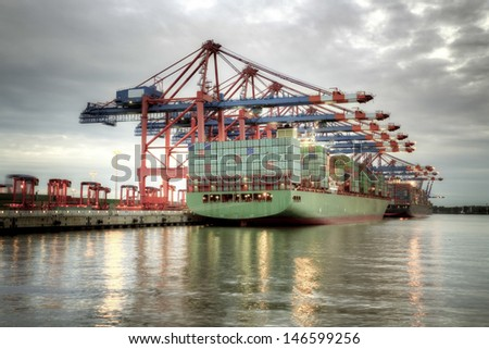 Container ship in the harbor of Hamburg. - stock photo