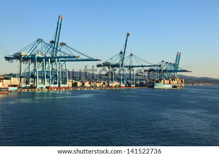 container ship in the port of algeciras, spain - stock photo