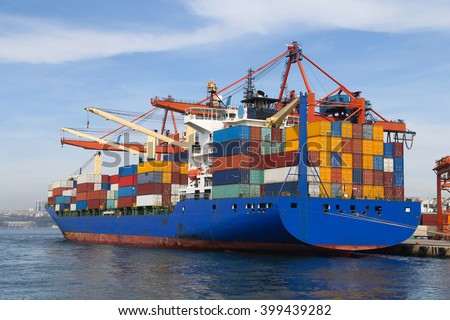Container Ship is loading in a port - stock photo