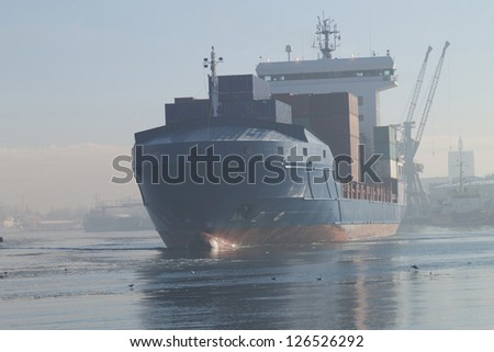 Container ship leave port of Gdansk