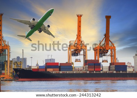 container ship loading on port and cargo plane flying above for water and air transportation industry - stock photo