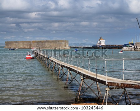 Container Ship moored in a Harbour on the Dorset Coast in England - stock photo