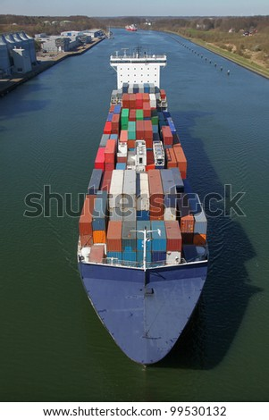 container ship on Kiel Canal - stock photo