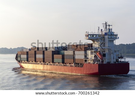 Container ship on the river Elbe near Hamburg, Germany