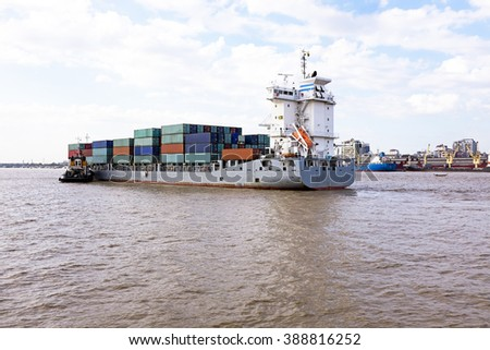 Container ship on the Yangon river near Yangon in Myanmar