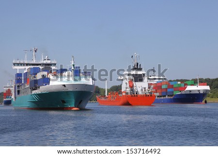 container ships and a tanker on Kiel Canal - stock photo
