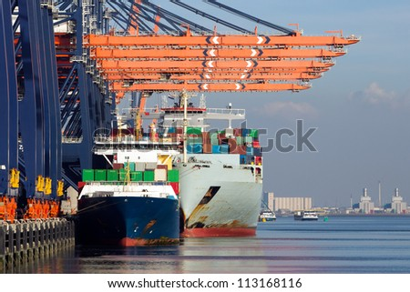 Container ships docked in the Port of Rotterdam, The Netherlands. - stock photo