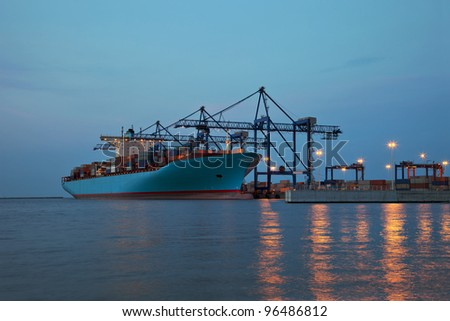 Container terminal at twilight - stock photo