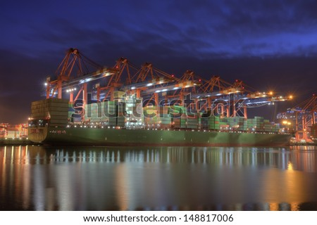 Container Terminal in Hamburg, Germany - during winter. - stock photo