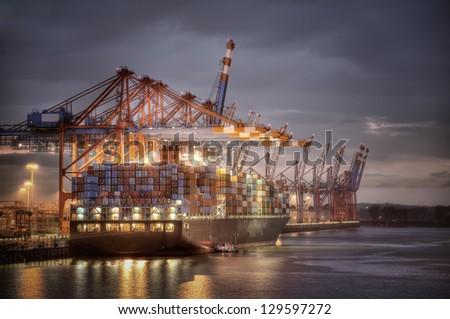 Container Terminal in Hamburg, Germany. Night shot. - stock photo