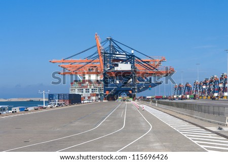 container terminal in the Rotterdam harbor - stock photo