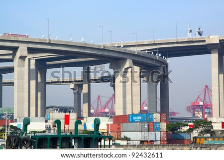 container terminal under flyover - stock photo
