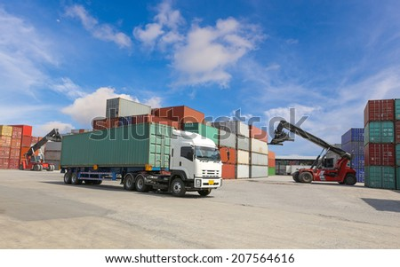 Container truck at dockyard with forklift background and blue sky - stock photo