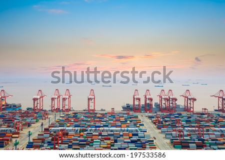 container wharf at dusk in shanghai  , the east china sea with sunset clouds  - stock photo