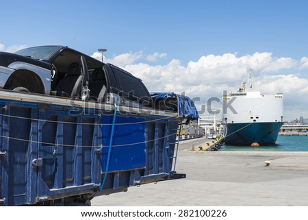 Container with scrapped car parked in the port - stock photo