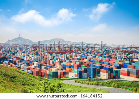 container yard under the blue sky  in shanghai yangshan deepwater port - stock photo