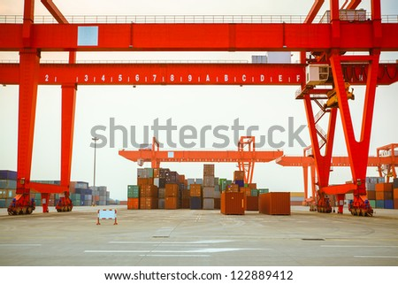 containers and cranes in an intermodal yard - stock photo