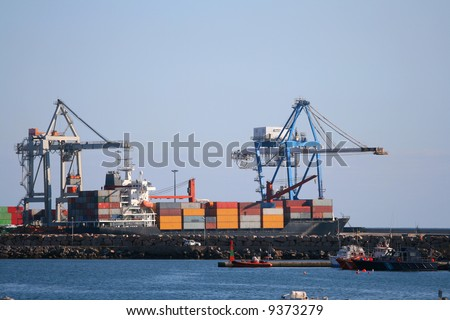 Containers at Castellon port. Logos and other names have been removed. - stock photo