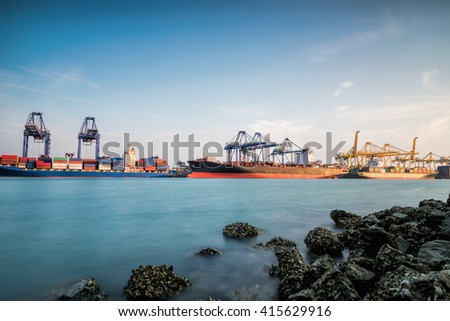 Containers cargo loading box by crane Trade Port Shipping - stock photo