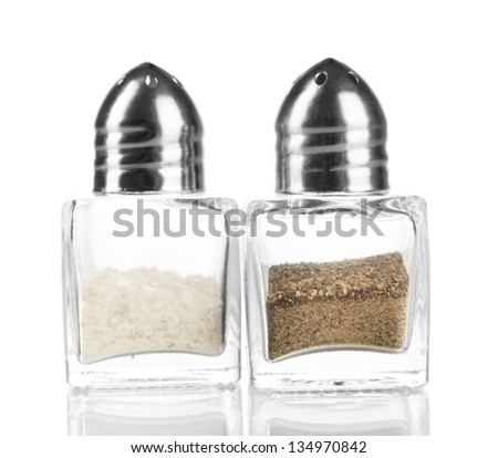 Containers for salt and pepper isolated on white - stock photo