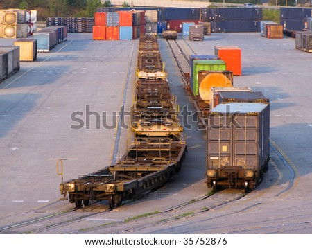 containers loaded on rail track for departure - stock photo