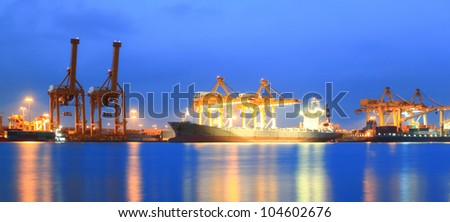 Containers loading at sea trading port Panorama - stock photo