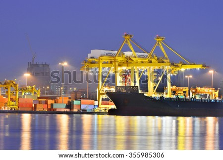 Containers loading by crane in the evening , Trade Port , Shipping - stock photo