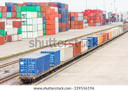 containers on train in industrial port authority - stock photo
