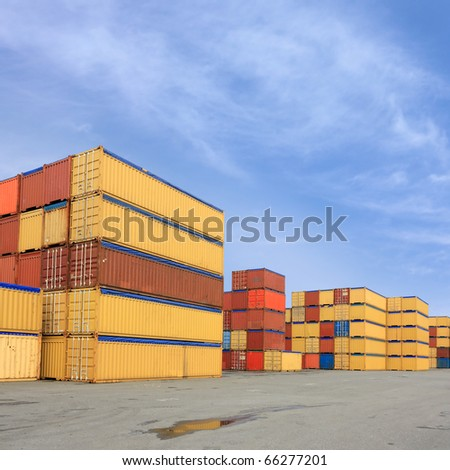 Containers waiting to be loaded in international harbor - stock photo