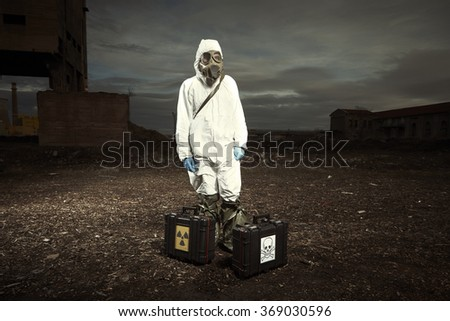 Contaminated area - man in field - stock photo