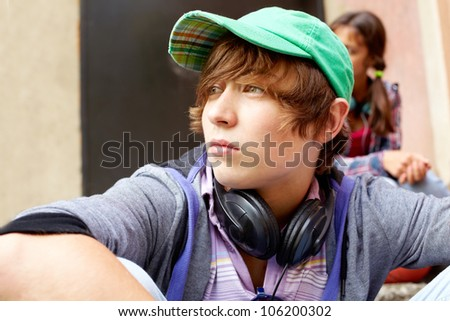 Contemplating teenager spending time outdoors in summer - stock photo