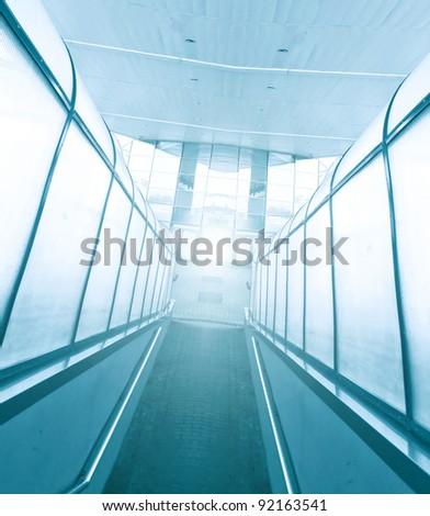 contemporary airport corridor in blue colors - stock photo