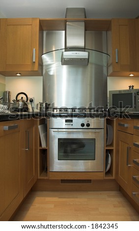 Contemporary apartment kitchen with stainless steel stove. - stock photo