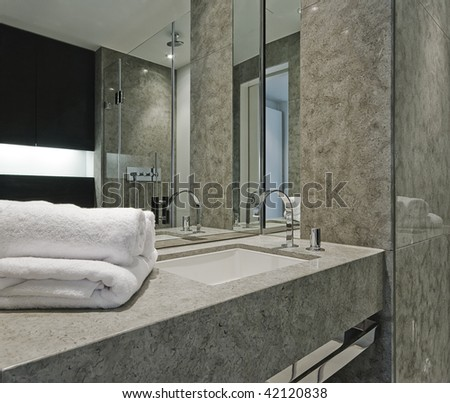 contemporary bathroom detail with marble and designer hand wash basin - stock photo