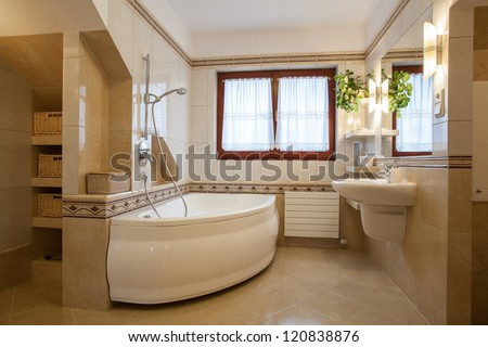 Contemporary bathroom interior, big bath and window