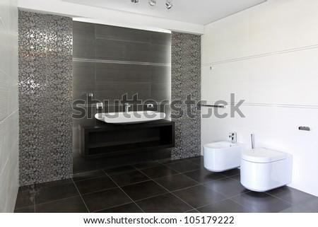 Contemporary bathroom interior in black and white - stock photo