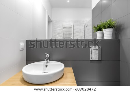 Contemporary bathroom interior with white round washbasin and big white and  grey tiles. Washbasin Stock Images  Royalty Free Images   Vectors   Shutterstock