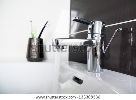 contemporary bathroom sink detail - stock photo