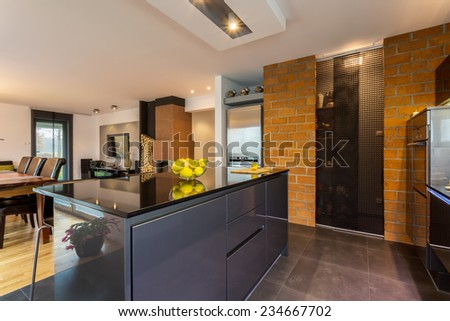 Contemporary beauty kitchen interior with kitchen island - stock photo