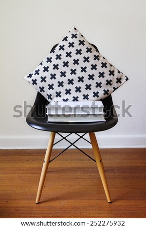 Contemporary black dining chair with modern cross pattern cushion - stock photo